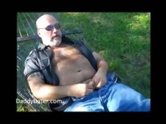 unshaved daddy bear jerking off on a sunny day