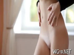 cutie plays with large fake penis