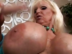 tanned blond with biggest zeppelins engulfing